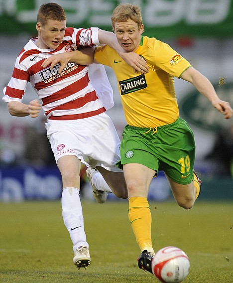 Celtic's Robson challenges Hamilton's McCarthy during their soccer match in Hamilton